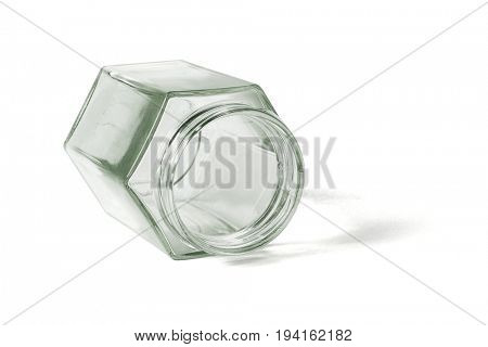 Empty Hexagonal Shape Glass Container Lying on White Background