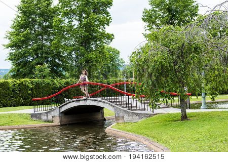Italian Lake Park in Harrisburg, the  capital city of Pennsylvania with young woman on red bridge