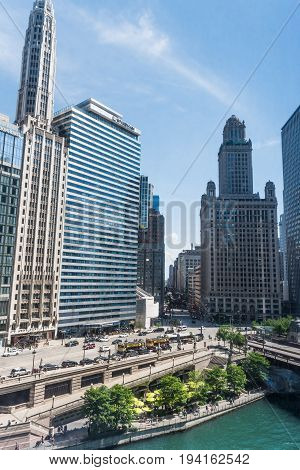 Chicago USA - May 30 2016: View of Wacker Drive with bridge skyscrapers people and cars in downtown with Wyndham hotel