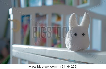 Plush toys on a cot