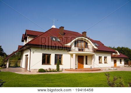 Single family big white house over blue sky