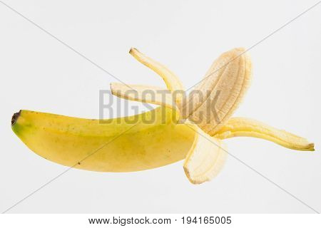 Half peeled banana (Musa acuminata) isolated on white background poster