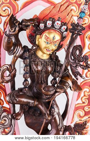 Yidam Red Tara in Vajrayogini's shape in a semi-angry form with the golden face and a knife cutting attachments.