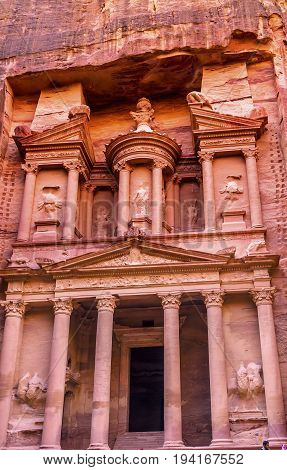 Yellow Treasury in Morning Becomes Rose Red in Afternoon Siq Petra Jordan Petra Jordan. Treasury built by the Nabataens in 100 BC. Canyon becomes rose red when sun goes down. Reds are created by magnesium in sandstone.