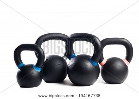 Four metal weights of different size and weight. White background isolated