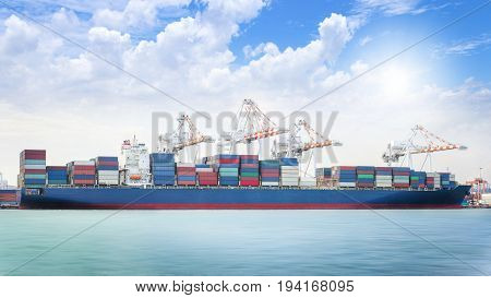 Logistics import export background of Container Cargo ship in seaport on blue sky Freight Transportation
