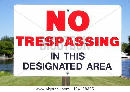 Closeup view of a No Trespassing sign for a specific area.