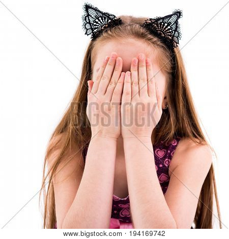 teen girl playing hide and seek, covering her face with her hands, playful and active