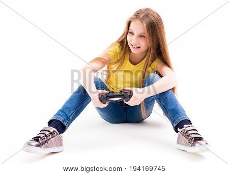 Cute teenage girl playing her computer games with a joypad, active and good gamer