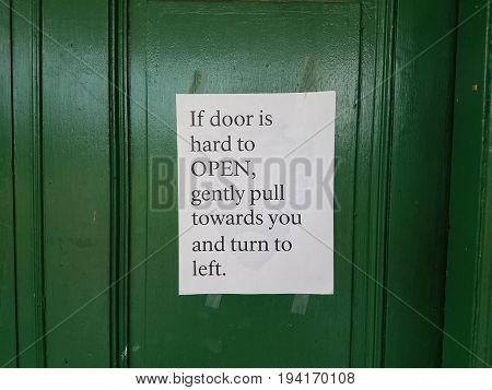 green door with instructions how to open it on paper