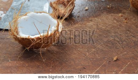fresh coconut on left side of cutting board