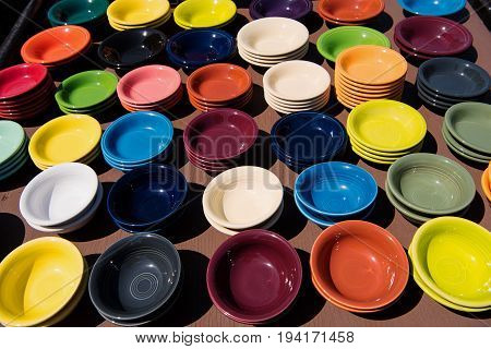 Colorful ceramic bowls at an outdoor flea market