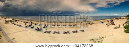 JURMALA, LATVIA - JULY 07, 2017: Panoramic view of sandy beach in Jurmala - famous Latvian international resort. One can see approaching thunderstorm