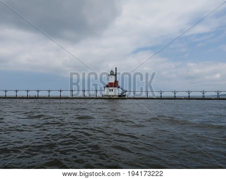 Lighthouse at North Pier in St. Joseph, Michigan on overcast day