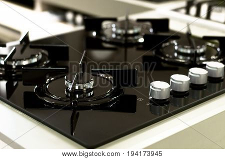 Stove top and gas cookers. Black stove surface. poster