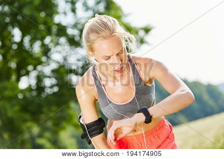 Woman controls her vital signs with smartwatch after jogging