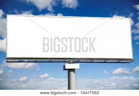 Blank billboard with space for your advertisement against blue sky