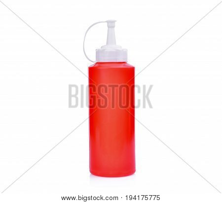 red plastic sauce bottle isolated on white background