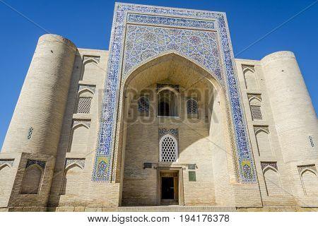 Mosque facade with typical mosaic Bukhara Uzbekistan