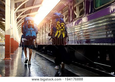 Young Couple lovers traveler in railway. Travel Concept.