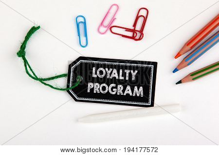 Loyalty program. Price tag with string on a white background.