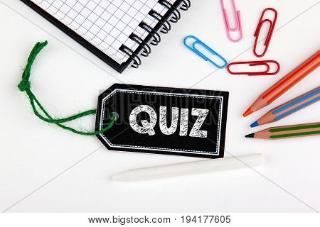 QUIZ. Price tag with string on a white background.