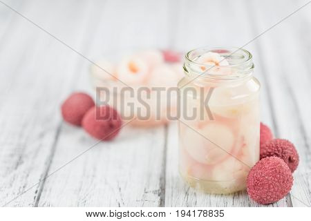 Wooden Table With Preserved Lychees (selective Focus)