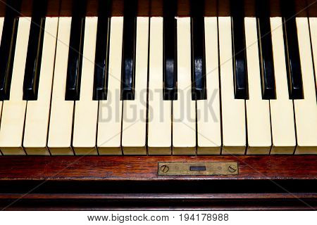 Antique Piano - closeup of keyboard with ebony and ivory keys