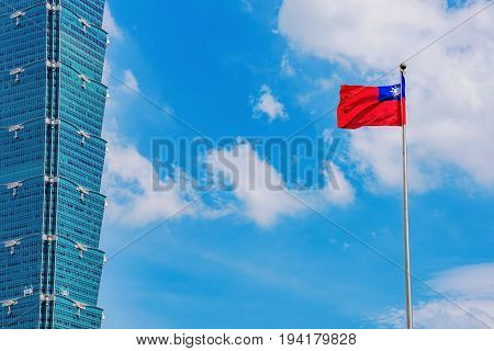 TAIPEI TAIWAN - MAY 31: This is a close up view of the Taipei 101 building exterior with a Taiwanese flag raised blowing in the wind in the downtown Xinyi area on May 31 2017 in Taipei