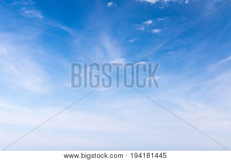 White fluffy clouds in the blue sky Fantastic soft white clouds against blue sky