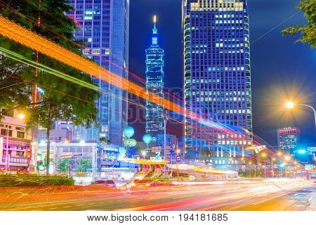 TAIPEI TAIWAN - MAY 26: This is a view of Taipei 101 and Xinyi financial district from a road in the downtown area on May 26 2017 in Taipei