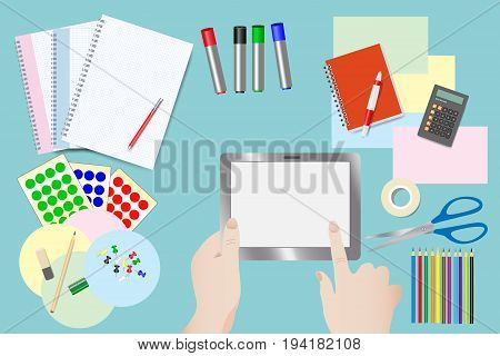 Hands touching tablet with empty screen over lying equipment for education and moderation.