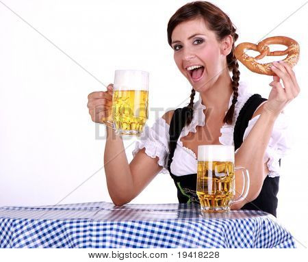 Bavarian brunette woman on blue white table with beer and snack