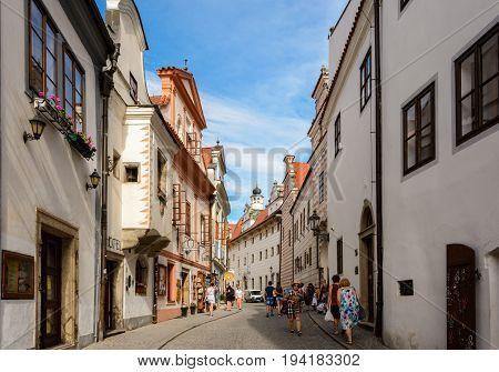 Cesky Krumlov, Czech Republic - June 9, 2017: Walk along the street on a sunny day in Cesky Krumlov
