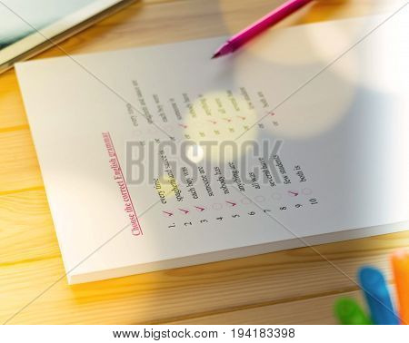English test sheet on wooden desk for exam