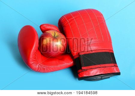 Boxing Gloves In Red Color. Pair Of Sportswear With Apple