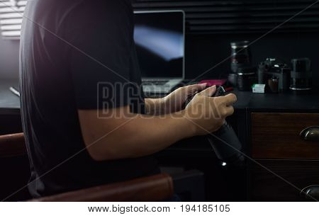 Photographer working checking photo Stylish home studio concept of hipster . Seleted focus.