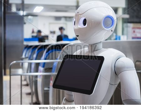KANAZAWA JAPAN - APR 11 2017 : Pepper Robot Assistant with Information screen at Train station Tourism Japan