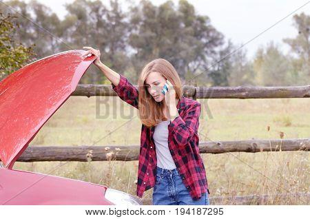 Woman With Phone Near Broken Car