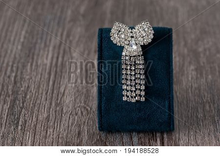 Brooch in the shape of a bow adorned with stones.Beautiful jewelry