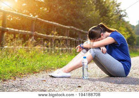Woman Resting After Jogging