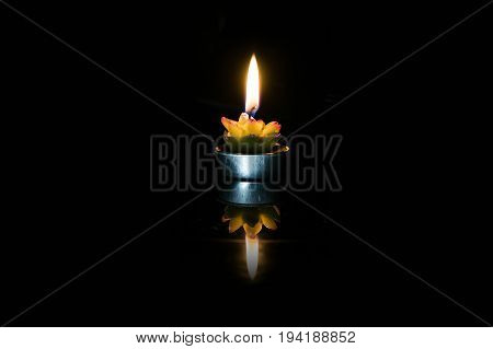 Burning Candle In A Candlestick