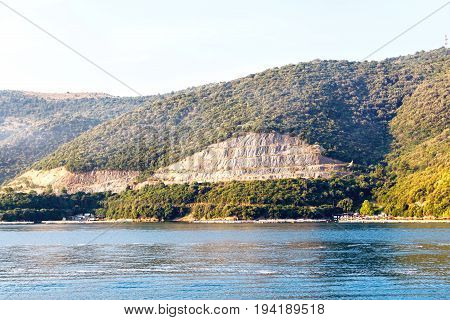 View from sea to Corfu island part and a port. Greece, sunset.
