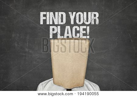 Businessman covering face with paperbag under find your place text on blackboard