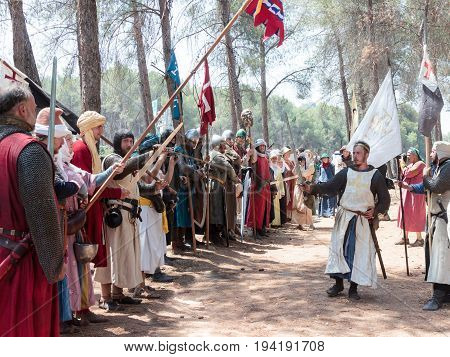 Tiberias Israel July 01 2017 : Participants in the reconstruction of Horns of Hattin battle in 1187 in the role of King of Jerusalem makes a speech before the soldiers in the camp before the campaign near TIberias Israel
