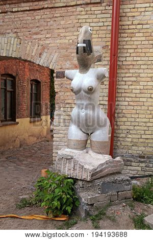 VILNIUS, LITHUANIA - JULY 20, 2015: Contemporary naked woman statue in Uzupio district, Vilnius, Lithuania. Uzupis republic is a bohemian and artistic district in Vilnius Lithuania.