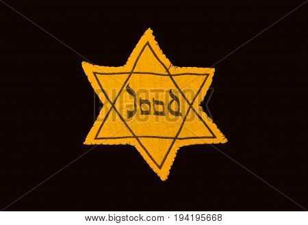 Yellow and black star which the Jews were required to wear in occupied Holland during World War 2 dutch language