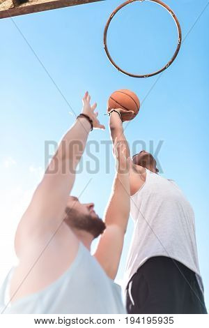 low angle view of multicultural basketball players during basketball game