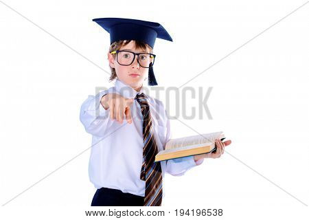 Portrait of a serious student boy in academic hat with a book. Educational concept. Isolated over white.