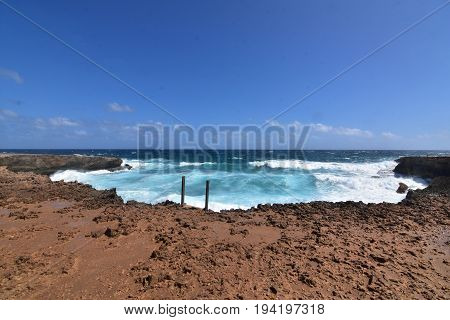Gorgeous look at the cove at Boca Mahos with crashing waves.